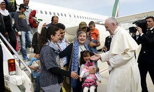 Pope Francis welcomes Syrian refugees as they arrive at Ciampino airport in Rome.