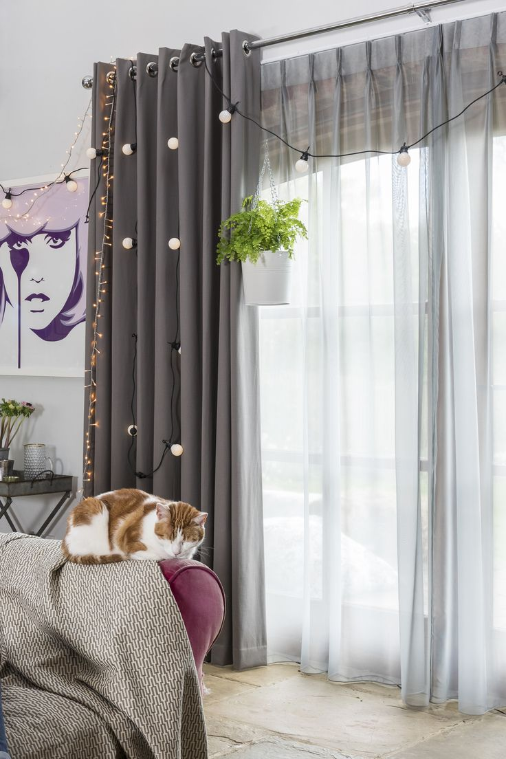 Gorgeous Tetbury Charcoal Curtains and Wisp Grey Voile Curtains from Hillarys helps create a summer style in your home. Click for more summer and festival inspired interior style tips from Jo Whiley