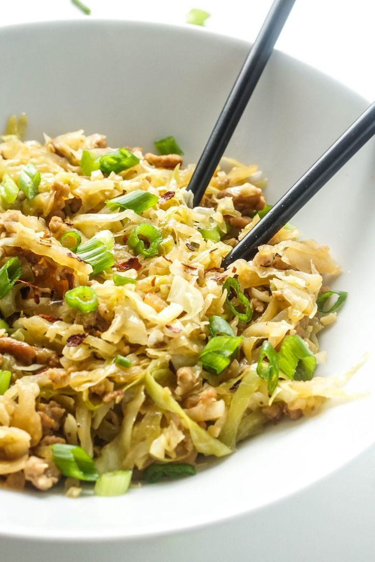 Egg Roll In A Bowl: 1 pound ground pork; 1 head of cabbage, thinly sliced; ½ medium onion, thinly sliced; 1 tablespoon sesame oil; ¼ cup soy sauce; 1 clove garlic, minced; 1 teaspoon ground ginger; 2 tablespoons chicken broth; Salt and pepper to taste; 2 stalks of green onion