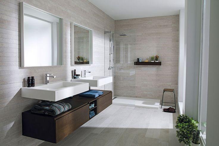 Bathroom   Porcelanosa Wall Tile: Liston Oxford Acero; Shower Enclosure: Attica; Shower Tray: Ras; Shower Column: Tina; Sink: Ras; Faucet: Irta; Undersink Storage Cabinetry: Ras; Mirror: KRION® framed