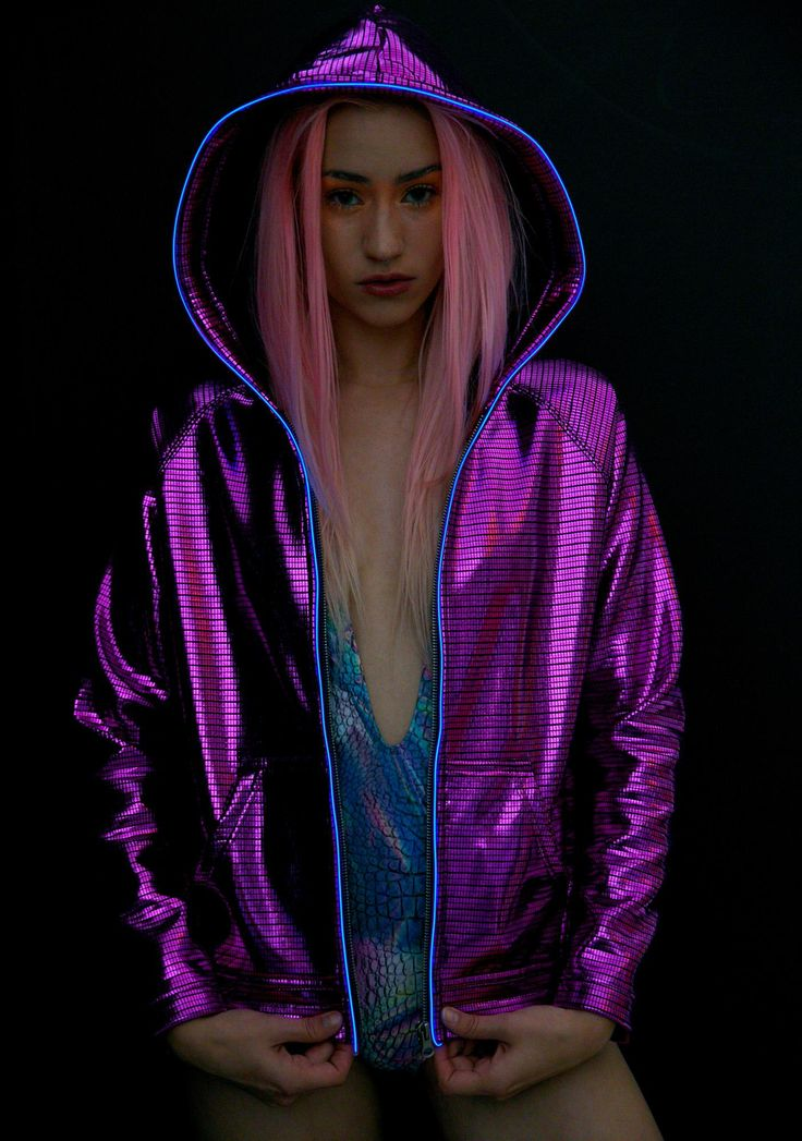 Electric Styles Electro Light-Up Hoodie are gunna help ya get yer glow on, babe! This awesome oversized hoodie features an insane reflective 'n shiny fuschia construction, front pockets, zip front closure, and dope electroluminescent piping around the hood and zipper. Get yer hands on tha super accessible light-up controlla in the pocket, and get to steppin' with 3 color changing modes~!