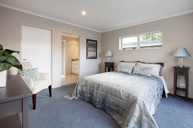A spacious master bedroom with an ensuite. The window above the bed brings plenty of light, a design feature we are seeing more of. #ClassicBuiders #newhomes #softfurnishings