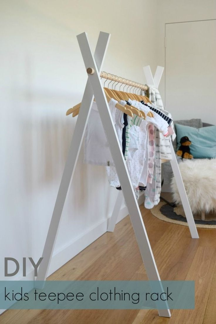 See how easy it is to make a low-cost kids teepee clothing rack! Hang your kid's clothes in style on this simple timber and dowel clothing rack...