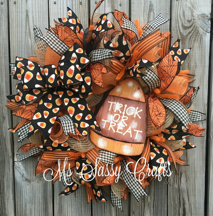 Halloween Wreath - Halloween Deco Mesh Wreath - Candy Corn Deco Mesh Wreath - Trick or Treat Wreath - Halloween Door Hanger by MsSassyCrafts on Etsy https://www.etsy.com/listing/464279858/halloween-wreath-halloween-deco-mesh
