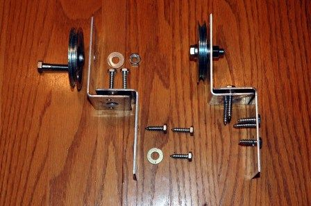 2 (3″) pulleys – this is a garage door part – $8.98    2 hex bolts (this replaces the bolt that comes with the pulley – receipt doesn't mention the size) – $2.16    2 (3/8) hex nuts (this fits above bolt) – $.70 and 2 lock-washers to fit – $.40    4 frame anchors – found with the decking supports  – $11.92    2 (1 1/2 x 1/4) lag screws – $.42 and 2 lock-washers to fit $.40    8 (1 x 1/4) lag screws – $1.20 and 6 lock-washers to fit – $1.60    4 (5/16) washers – $.48
