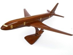 """A beautiful hand carved desktop model of the Boeing 777. The model has been carved from solid mahogany. The model comes boxed and is simple to assemble. The wings, tail fins and stand simply slot into pre-drilled holes on the body of the aircraft. No glue required. Size H 10"""", L 16"""", W 16"""". Visit our website at thewoodenmodelcompany.co.uk to view the full range of our models."""