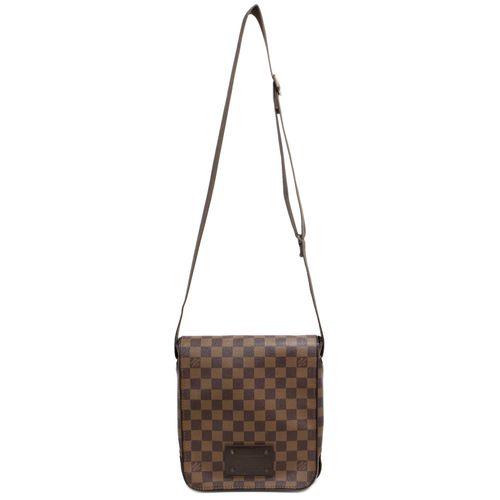 "Authentic Louis Vuitton Damier Ebene Brooklyn PM Messenger Bag  CONDITION: Good. Light wear on hardware, faint wear on leather trim  Material: Canvas Color: Dark brown, brown Date Code: CA5101 Exterior Features: Adjustable shoulder strap, magnetic flap opening, bronze hardware Interior Features: Brown fabric lining, slip pocket, pouch pocket Measurements: 9"" x 10"" x 2.25"" SKU: HA02094"