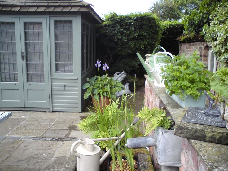 Summerhouse in Farrow and Ball's Pigeon. Nice lead water feature and trough. Alison Dodds garden. http://www.facebook.com/alison.dodds.39