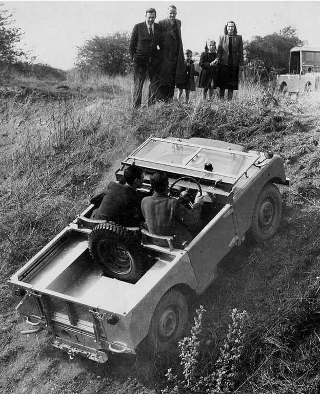 Series One Land Rover in 1949 being driven up a hill