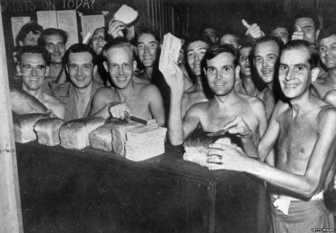 1945: Prisoners of War from the Allied forces eating food after being liberated from a Japanese Prisoner of War camp in Taiwan