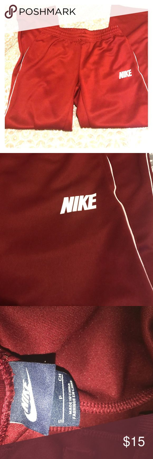 Nike jogger pants A dark red/ wine color jogging pants! The material is so soft & flexible. Has pockets on the sides & one on the back. These pants are for both man & women. It has a loose fit on the ankles. Also has adjustable waist band. Nike Pants Track Pants & Joggers
