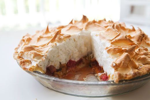 Tart and tangy rhubarb meringue pie with orange zest, cinnamon, ground ginger, piled high with a light and fluffy meringue.