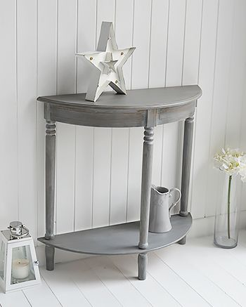 The White Lighthouse grey console and sofa tables for your living room and hallway. The British Colonial Grey Furniture, half moon console table with shelf
