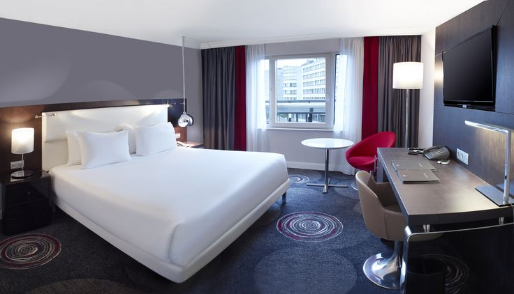 Stretch out and relax in a modern, spacious guest room and enjoy thoughtful amenities - Hilton Brussels Grand Place