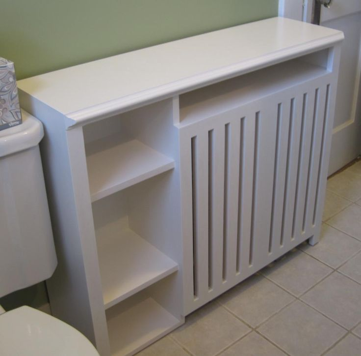 Radiator Enclosure Cabinet: Custom built for a small bathroom, this cover provides ample shelf space and even a bay for warming towels.