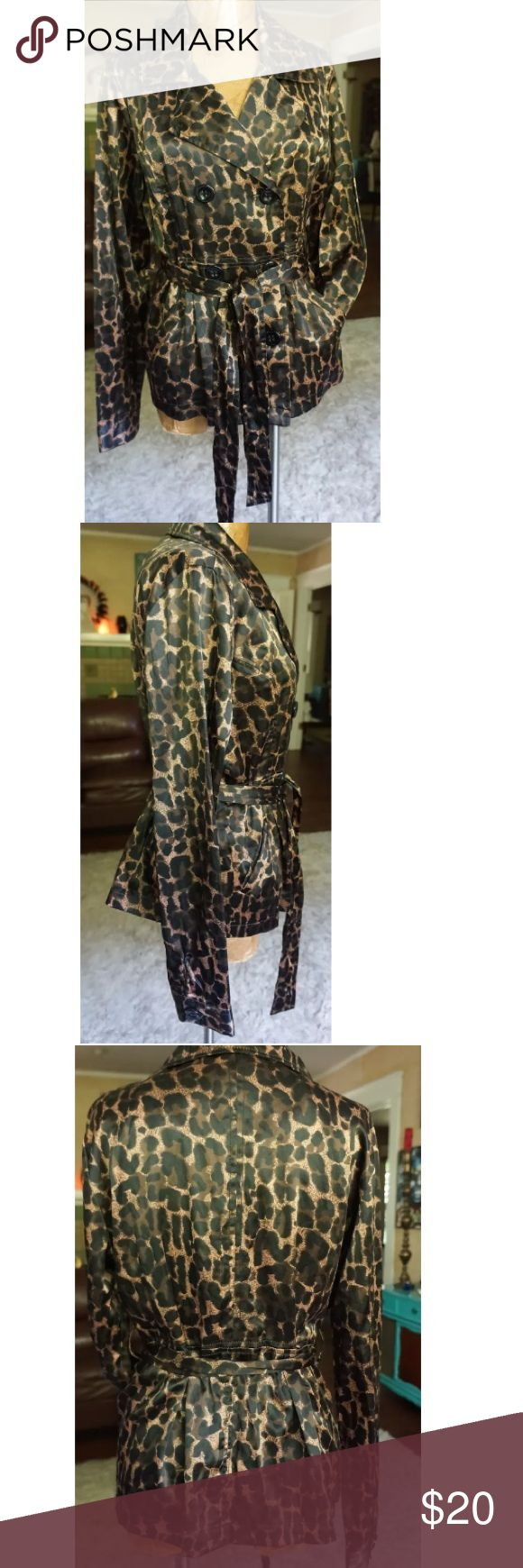 Satin leopard jacket tie waist size M Gorgeous satin like trench leopard juniors size XL this would fit a women's size M  fun and funky for fall and winter! Inside button missing one belt loop is missing super fly jacket! emely 26 International Jackets & Coats