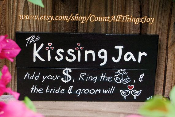 """The Kissing Jar.  Add your $, Ring the bell & the bride and groom will kiss""  For wedding reception. This hand-painted rustic wooden sign is approximately 12""x6"". It is shown made from two boards but can be made from one wide board if preferred. It can be custom painted in the color your choice, and distressed if desired. Signed . The entire project is finished with an interior satin sealer."
