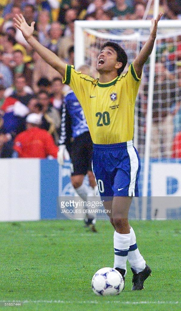 Brazilian forward Bebeto jubilates after scoring the 1-1 equalizer during the 1998 Soccer World Cup quarter-final match between Denmark and Brazil 03 July at the Stade de la Beaujoire in Nantes. Brazil is leading 2-1 in the first half.