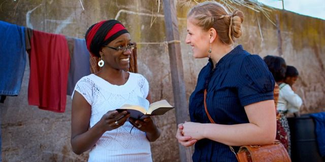 Cameron shares a Bible verse with a woman in Malawi