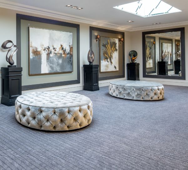 On the second floor of this stunning Millgate development, we used bespoke ottoman seating in fabric by Todays Interiors, along with bespoke large scale artwork sitting beautifully upon leather effect wallpaper panels by Tektura.