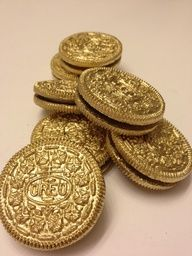 Gold Oreos would be perfect for a pirate party! I'm guessing just gold food spray paint.