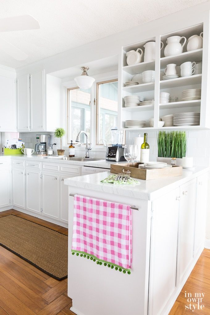This white kitchen used to be a brown kitchen. DIY Kitchen makeover BEFORE and AFTER.  Tips for DIYing painting cabinets, countertops and more.