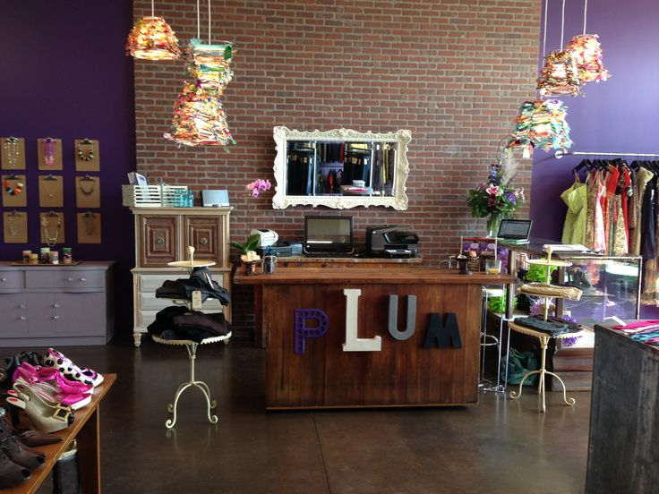 Plum Cash Wrap; I see some clipboards off to the left too, nice lights above and around the cash wrap.