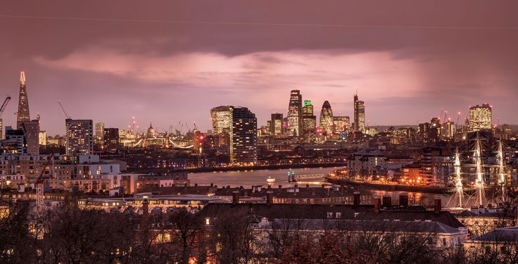 The view from Greenwich Observatory as the rain cloud breaks over the city at dusk