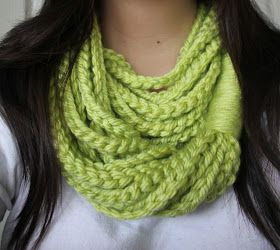 HiddenDaisyy: Chain Loop Scarf.  Really simple!  Just do 12 (ish) chains of crochet with chunky yarn, and fasten them together.  Pretty!