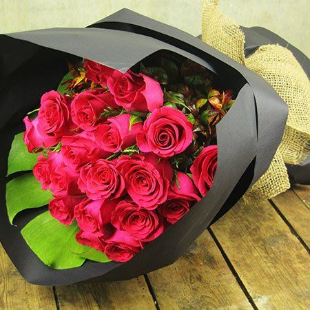 """Buy """"Hot Pink Rose Bouquet"""" for $59.95. When Only Ravishingly Hot Pink Roses Will Do... Send Roses In A Divine Bright Pink Offset With Lush Foliage And A Smart Black Wrap Starting From $59.95 For Ten Stems. Available In Three Bouquet Sizes Plus As A Flower Arrangement In A Vase, These Fabulous Girly Girl Roses Are Perfect For Celebrating Birthdays Or Babies! You Can Order Our Darling Pink Roses Online Or By Calling The Florist Team. Ps. This Bouquet Would Go Perfectly With A Bar Of Kennedy…"""