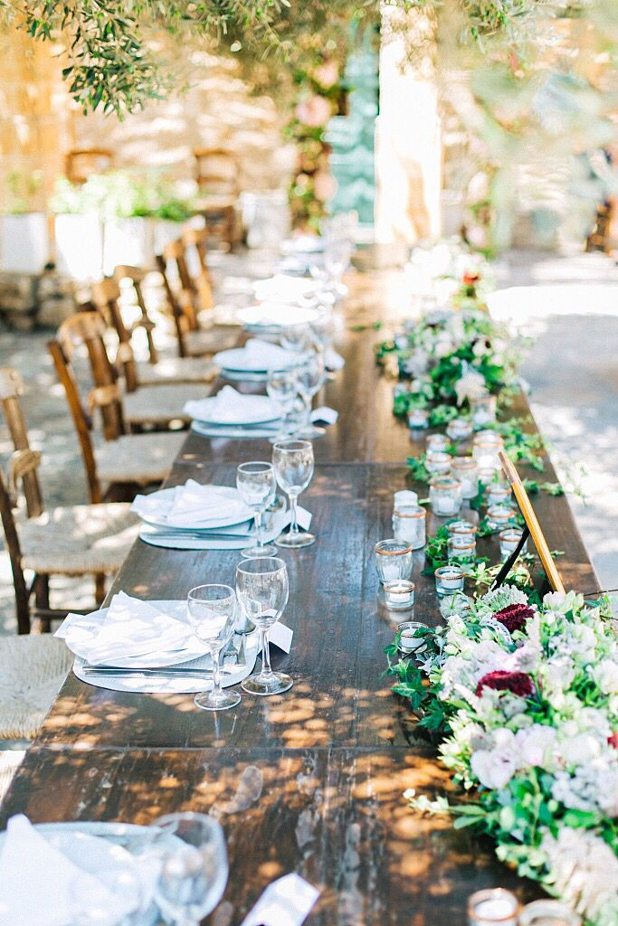 Farm wedding reception table setting by the talented Fabio Zardi, bright and full of texture.