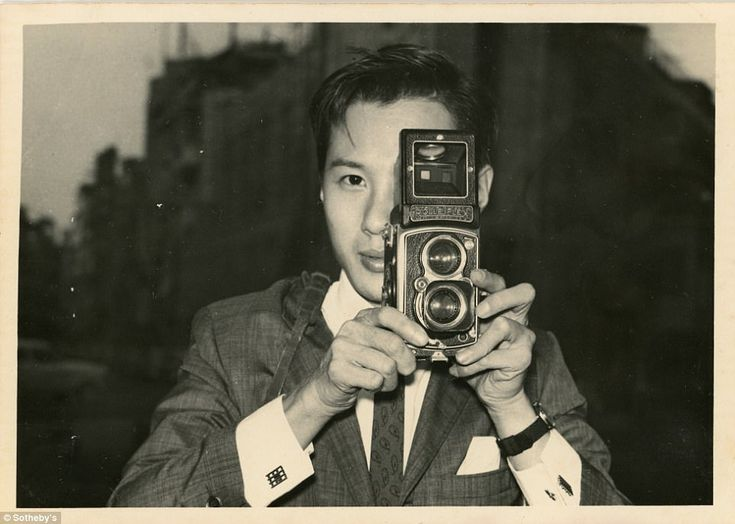 Mr Ho took a self portrait  with his  camera. He was wildly regarded as the most famous photographer from Hong Kong