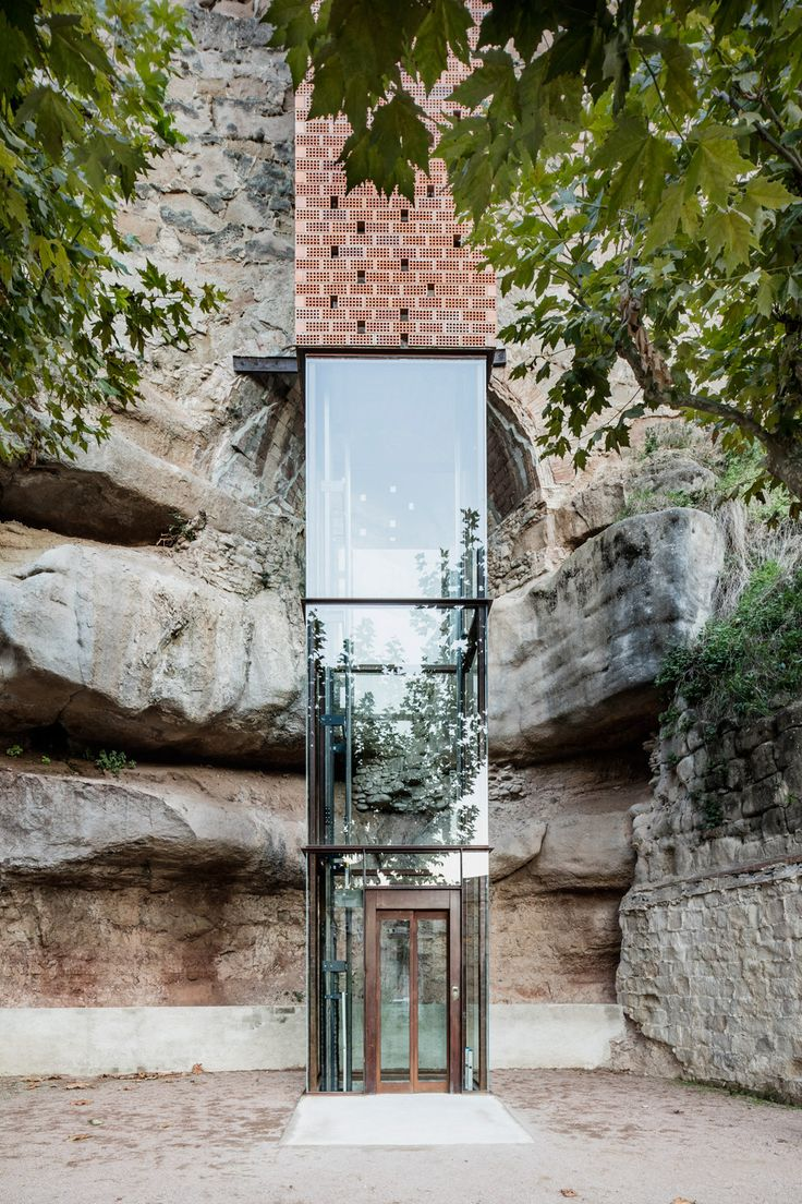Spanish architect Carles Enrich has built a 20-metre-high elevator next to a Catalonian cliffside to connect the old and new parts of a town.