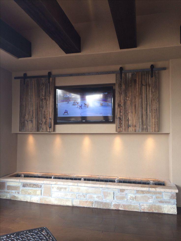 Outdoor tv with fountain below