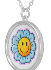 """Wear the Smiley Riley Sunflower in this beautiful round sterling silver plated necklace. Complete with a lobster claw clasp, this necklace is finished with a UV resistant and waterproof coating to protect the Sunflower image for years to come. The necklace is 18"""" in length with a 1.44"""" charm, and arrives in a special black felt bag that is perfect for gifting. Any girl will love it! Suggested age range: 5-12 years."""