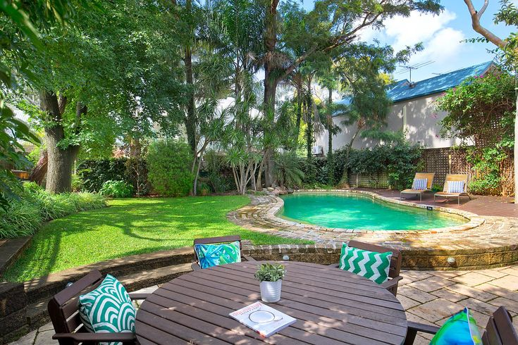Large in-ground salt water pool, pool side patio, private sunny backyard, established gardens, Pilcher Residential