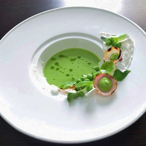 "By @snickety_lemoine ""Warm Pea Soup   Butter Glazed Peas   Goats Cheese   Charred Sweet Onions   Pea Puree   Lemon Verbena   Nasturtium   Mint Oil."""