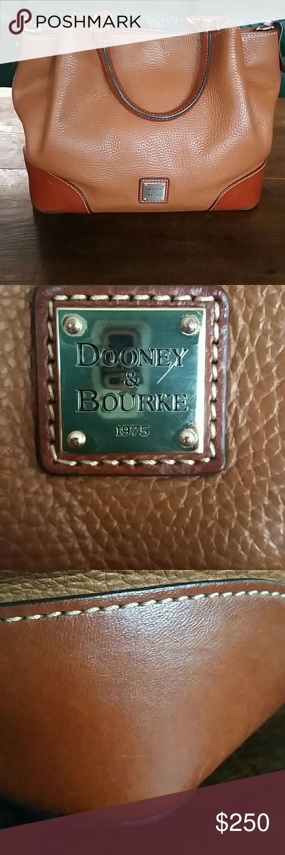 DOONEY & BOURKE brenna satchel caramel color has two pen marks that can be cleaned off with proper products I just don't have them the bottom leather trim needs to be cleaned as well I will have an additional post with more photos of the inside of the bag Dooney & Bourke Bags Satchels