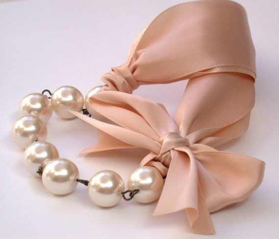 Carrie Bradshaw  Inspired Pearl Necklace In Nude Color Satin Ribbons. Perfect for Bride, Wedding, Bridesmaids And Formal.   Inspired by my favorite - Carrie Bradshaw in Sex and The City!   Beautiful and very delicate Nude Color Satin ribbons are connected to a brass ovals, gorgeous light peach Czech glass pearls and bow on one side finish the look. The necklace is adjustableand hangs at approximatley 17 inches + an extension chain, and closes with a brass lobster claw clasp.