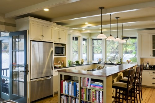 I love how bright this kitchen is with all of the windows, the extra storage at the end of the island, the bar and sink sharing the island, the hanging lights... love it :)