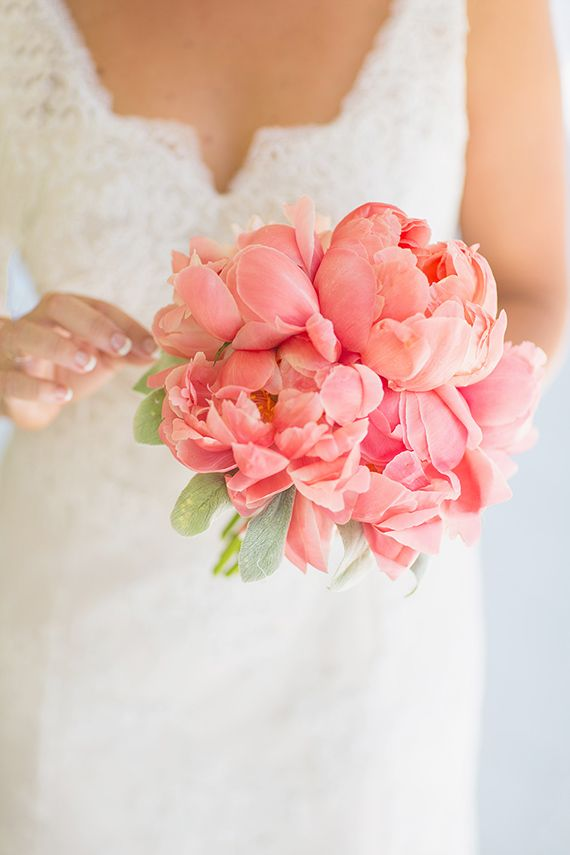 The older flower girls will carry coral peonies and sage leaves wrapped in soft gold with the stems showing.