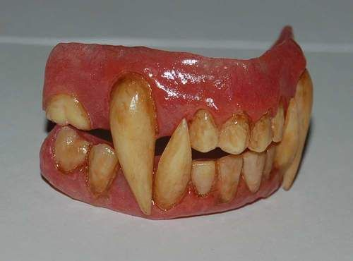 A set of werewolf teeth based off the character George in the BBC series of Being Human. mid transformation, this is kinda what his teeth look like