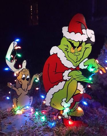 The Grinch and Max stealing Christmas lights - yard art available at Etsy.