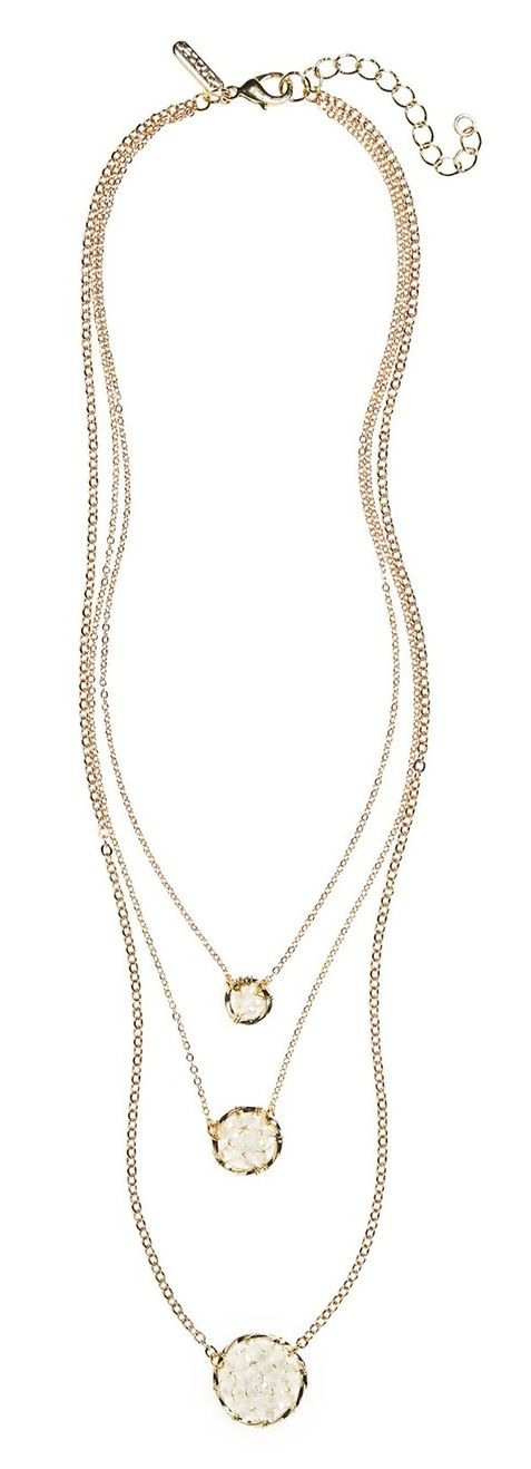 Crushing on this layered necklace with shimmering crystal beads strung on a delicate gold chain.