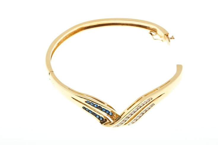 18ct Yellow Gold Diamond and Sapphire Bangle featuring Australian sapphires    Even better, it's on SALE at the VDT online store http://victoriandiamondtraders.com.au/product/1460/18ct-Yellow-Gold-Diamond-and-Sapphire-bangle#.UZmrh6LX-8A