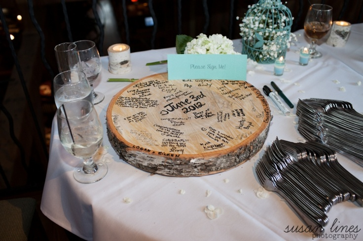 Using an old tree stump as a guest book. Super cute anddd saves money!