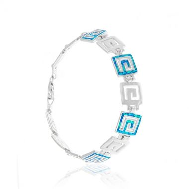 A sterling silver bracelet featuring the ancient Meander motif with blue opal inlay. Symbol of eternity and unity, prominent on ancient greek architecture, pottery and jewellery, the sterling silver Meander with the vibrant blue opal inlay, creates an exquisite combination bound to attract attention. Wear it alone with your favourite casual outfit and add a dash of glamour. For glamorous nights match it with a delicate blue opal sterling silver necklace.