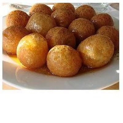 loukoumades - warm mini-doughnuts served with cinnamon and honey...