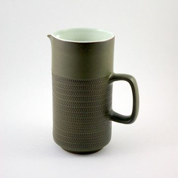 Here, famed British pottery maker, Denby, works in the trending-aging chevron pattern otherwise known as the Camelot pattern. This straight-sided, two-pint pitcher is glazed in a lovely shade of green with a band of printed pattern around the center and comes with a sturdy handle.