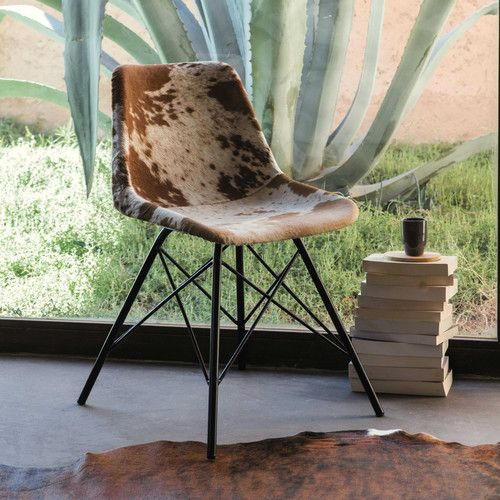 Chaise en peau de vache et métal